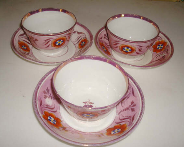 PINK LUSTRE HANDLESS CUPS AND SAUCERS, THREE, EARLY 19TH C.