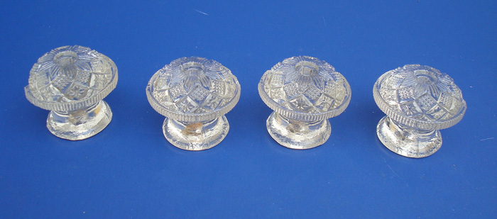GLASS PULLS OR FURNITURE KNOBS, FOUR CLEAR PRESSED GLASS, 19TH C.