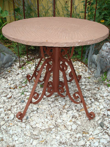 GARDEN TABLE, ANTIQUE ROUND STONE TOP OVER WROUGHT IRON BASE, 31 INCHES WIDE