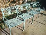 FOUR ARMCHAIRS IN STAR AND DOLPHIN PATTERN, CAST ALUMINUM