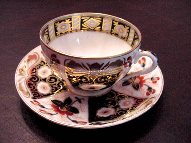 Germain Porcelain Tea Cup and Saucer in a Paneled Imari Pattern with Gilt Decoration