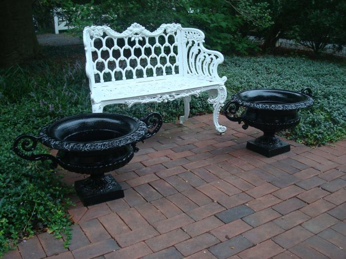 SET OF FOUR ANTIQUE CAST IRON URNS WITH HANDLES