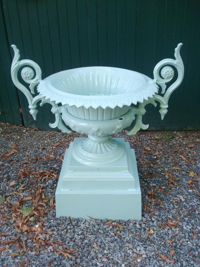 CAST IRON URN WITH HANDLES,  19TH C.