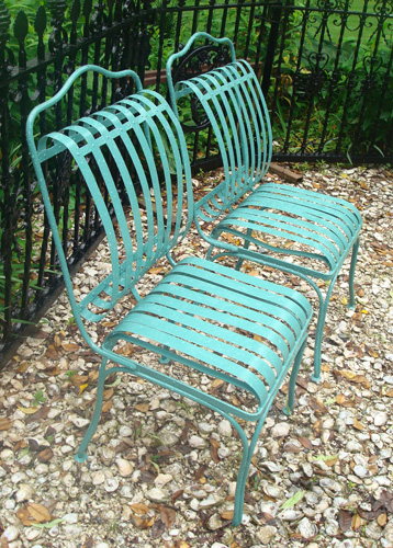 Pair of vintage spring form or bent steel garden chairs,early 20th century,  in a design of curved vertical steel strips after a French design patented  by ...