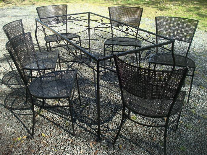 SALTERINI TABLE AND SIX WROUGHT IRON CHAIR SET