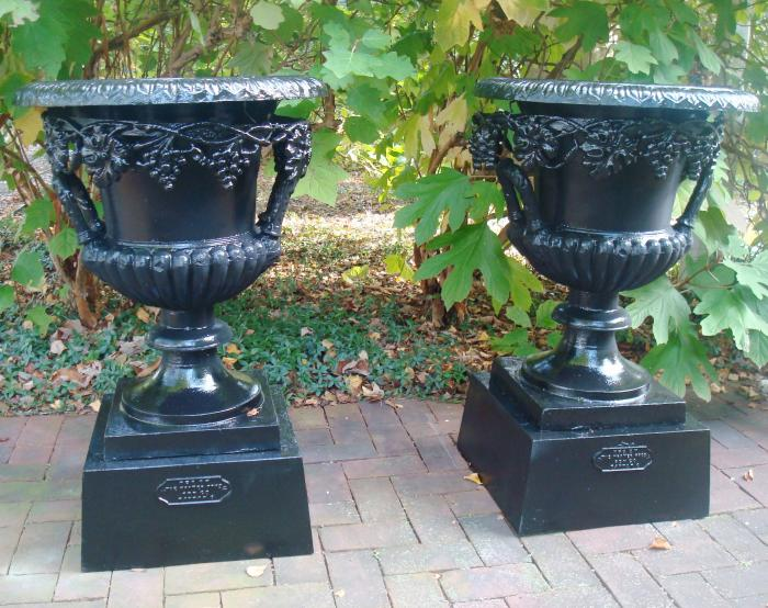 PAIR GRAPEVINE CAST IRON URNS, LABELED KRAMER BROS. FDY