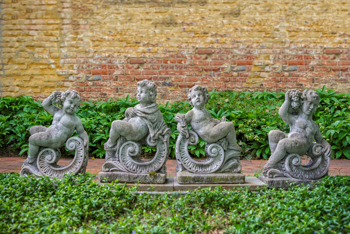 FOUR SEASONS STATUES, ANTIQUE CAST STONE, PUTTI WITH SCROLLS